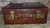 Lovely patinated vintage leather dress case, with brass fittings.